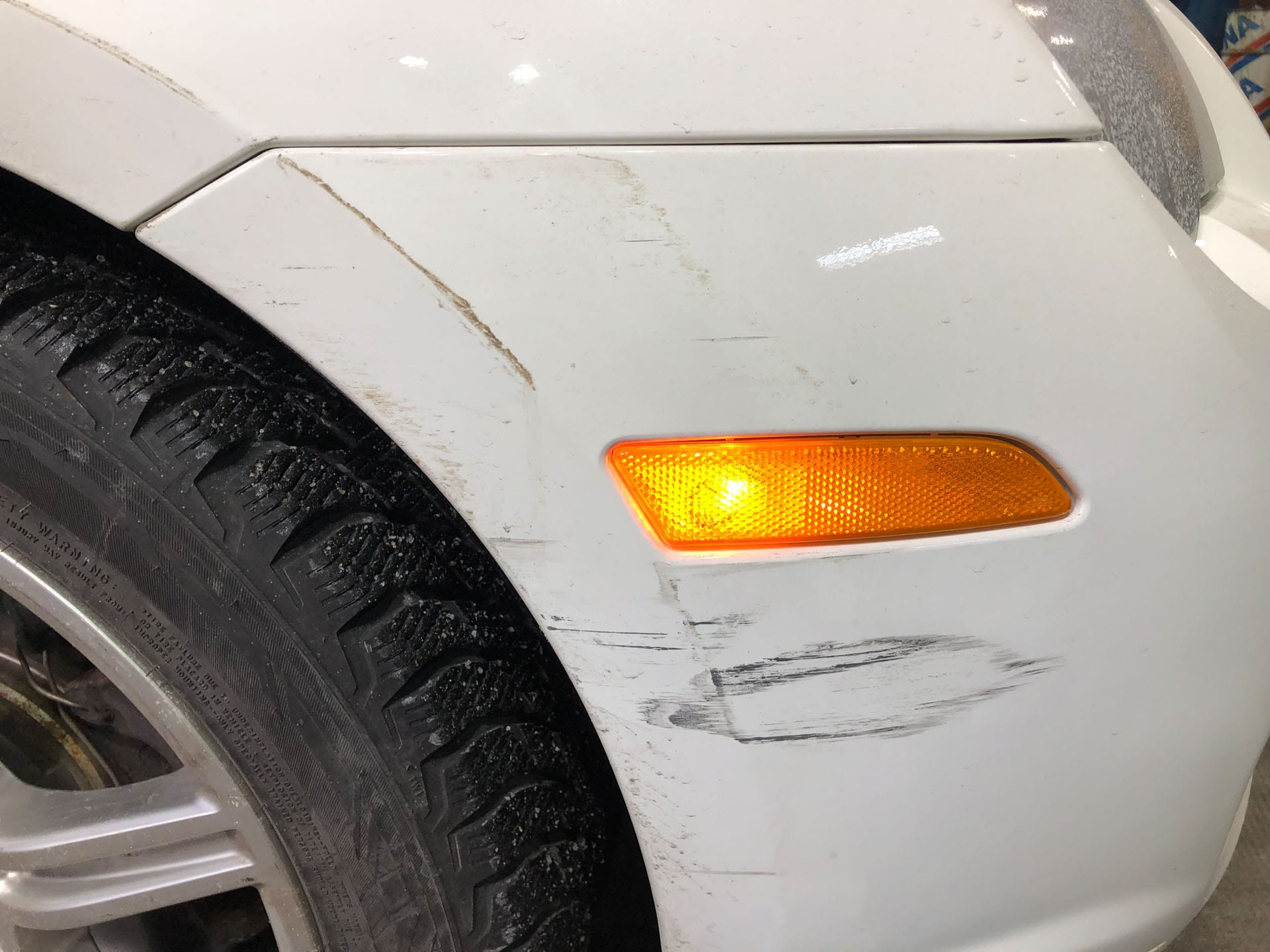 Scratched white car